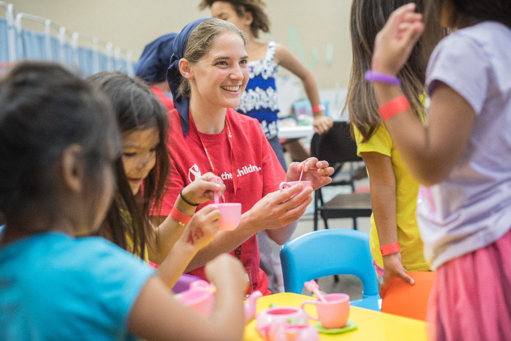 A young woman from the Bruderhof working with children as part of a Save the Children response in Houston, Texas after Hurricane Harvey