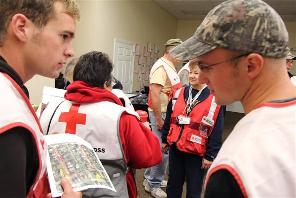 young men from the Bruderhof working with Red Cross