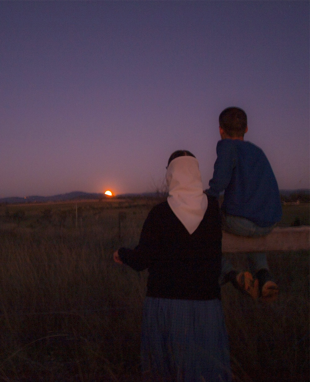 The author and one of her sons watching the moon rise