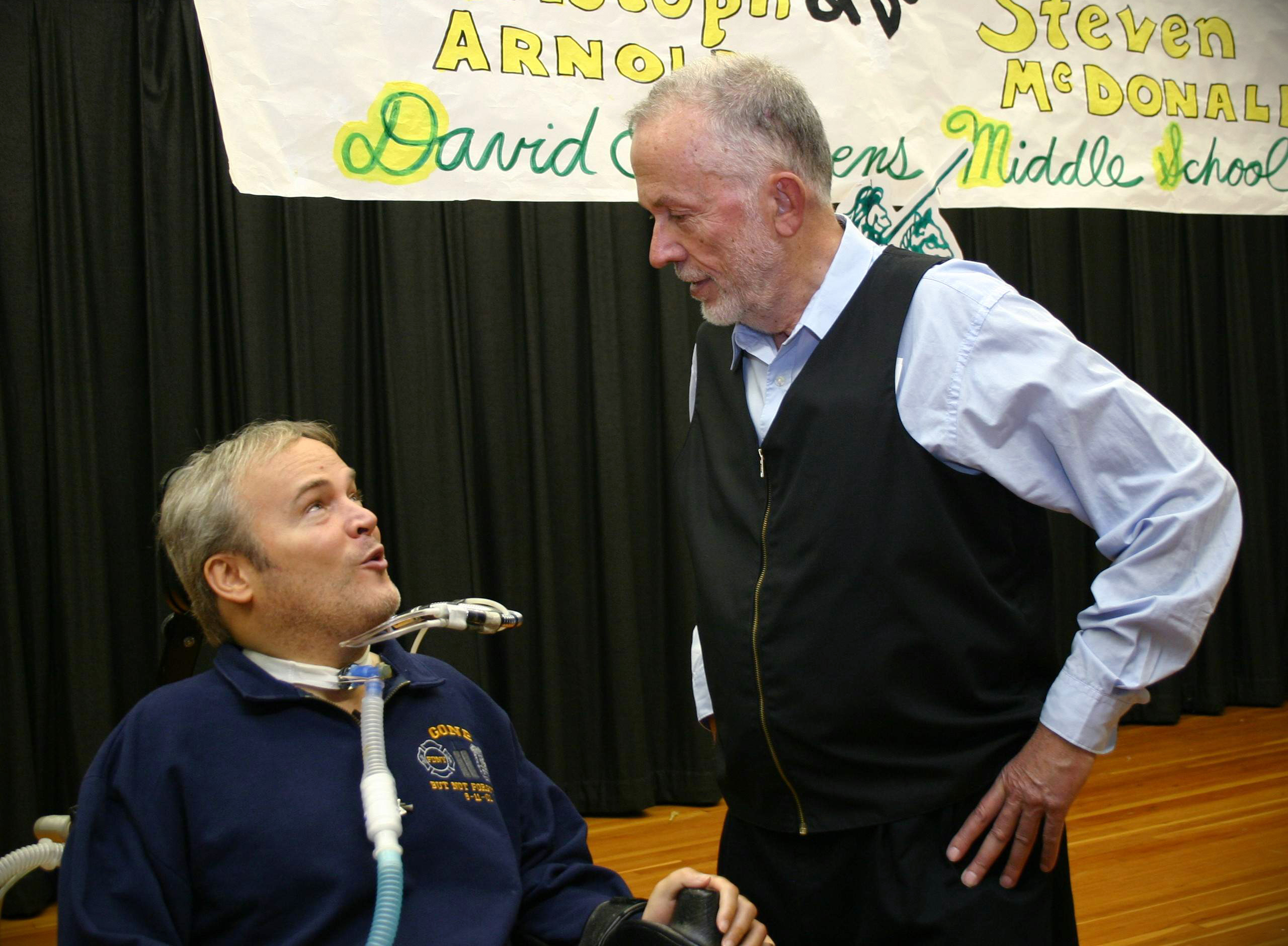 Johann Christoph Arnold and NYPD Detective Steven McDonald talking together after a Breaking the Cycle assembly