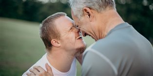young man with Down syndrome and his dad