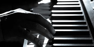 Pianist playing a piano