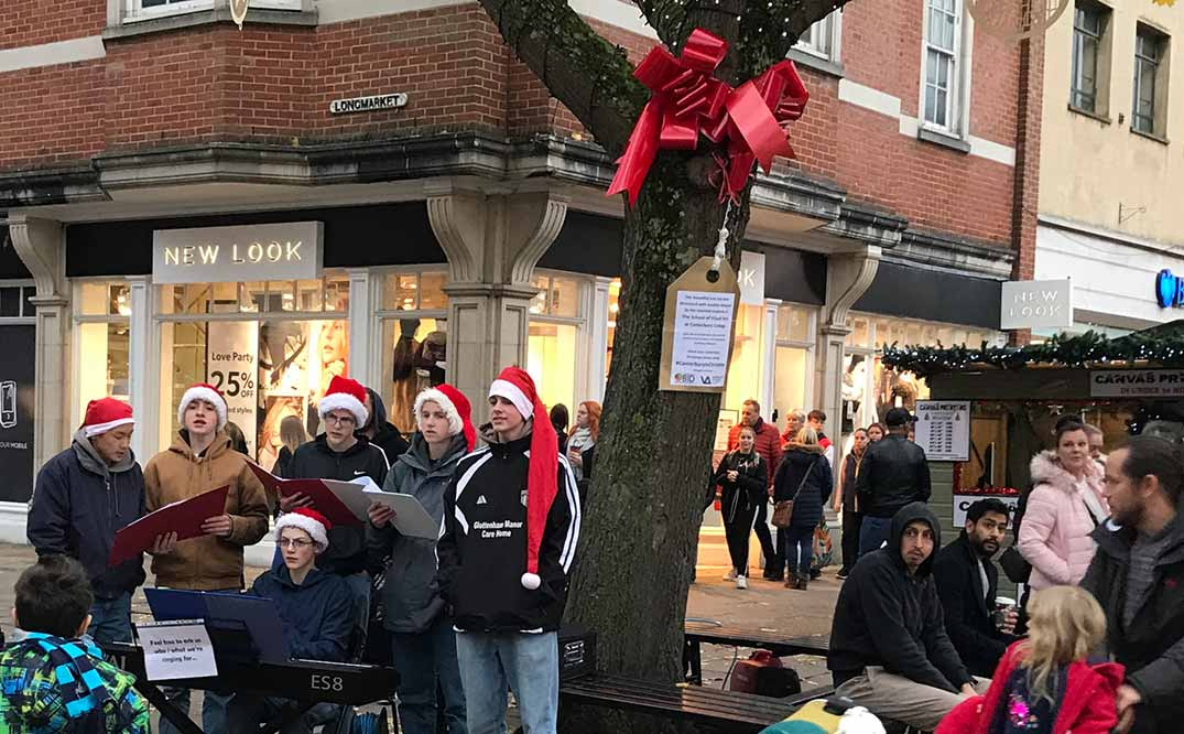 Throngs of shoppers, tourists, and students are regaled by music.