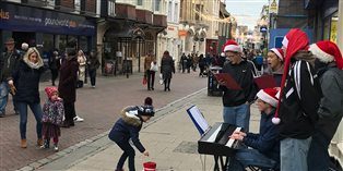 Students busking on High Street Canterbury