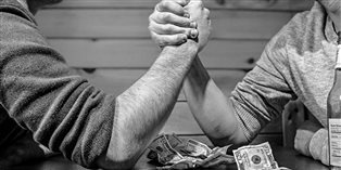two men arm-wrestling for money