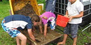 kids mixing compost for their garden