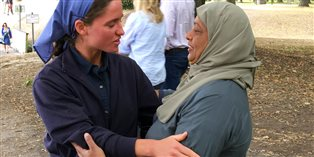 Young woman from the Bruderhof speaking with a Muslim woman in Christchurch, New Zealand