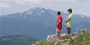 Andrew's sons savor the view in their new homeland of Austria.