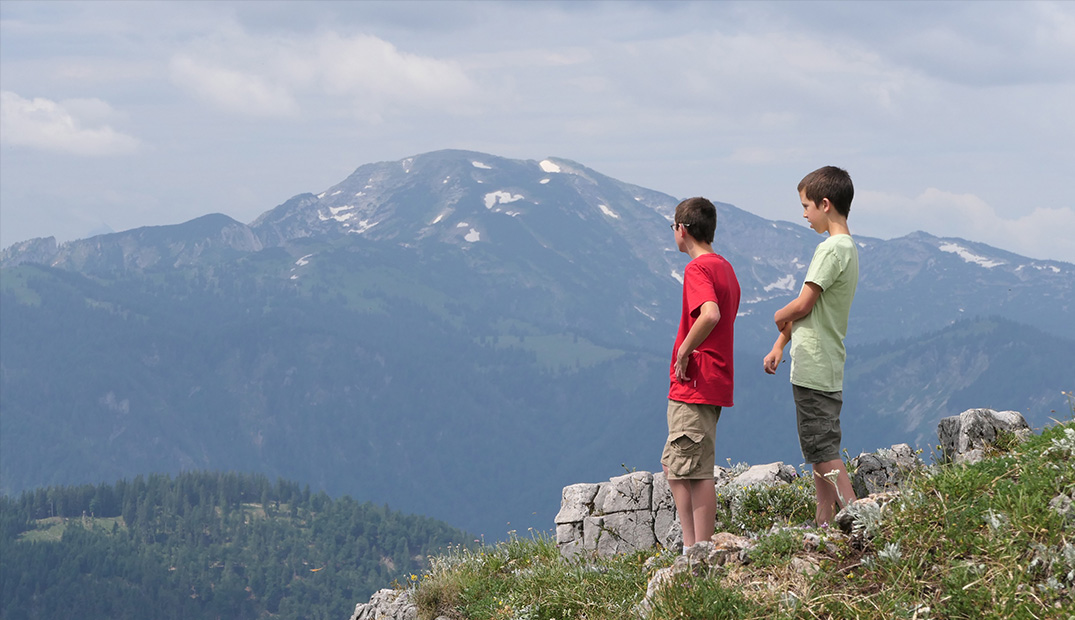 Andrew's sons savor the view in their new homeland, Austria.