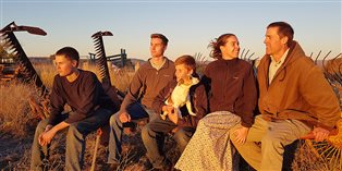 Norann and Chris Voll and their three sons, Australia